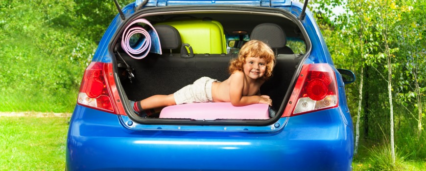 Boy in the trunk with baggage